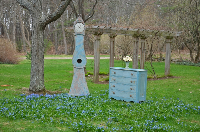Blue Painted Antiques With Blue Spring Flowers
